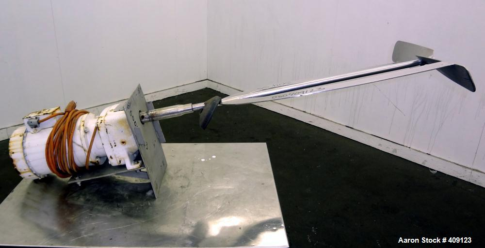 """Used- Top Entering Agitator. Approximate 3/4"""" diameter 304 stainless steel shaft with a dual paddle type mixing blade, drive..."""