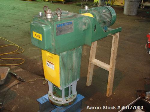 Used- Lightnin agitator, model 72-S-5. 21 to 1 ratio, output 84 rpm, mechanical seal. Driven by a 5 hp ,3/60/460 volt XP mot...