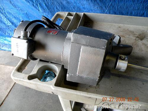 """Used- Lightnin Clamp-On Agitator, Model ND-1. 5/8"""" diameter x 50"""" long 304 stainless steel shaft with a 9"""" diameter 316 stai..."""