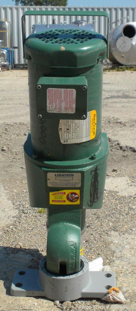 Used- Lightnin Top Entering Agitator, Model X5P75. Cup plate mounting. Driven by a 3/4hp, 3/60/230/460 volt, 1725 rpm motor....