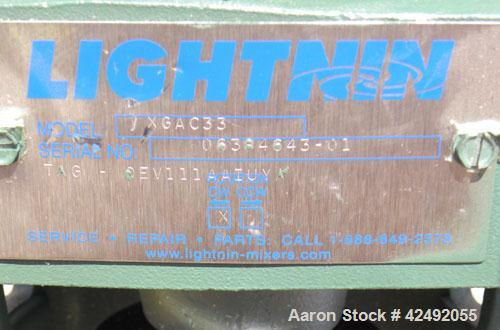 Used- Lightnin Fixed Mount, Closed Tank Design, Air Operated Agitator, Model XGAC33. Clockwise rotation. Approximate 4'' dia...