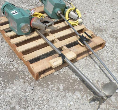 Used- Lightnin Clamp-On Agitator, Model XJ-350. 1-1/2'' diameter x 73'' long 316 stainless steel shaft, 4 bolt hole mounting...