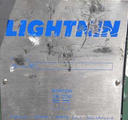 Used- Lightnin Fixed Mount, Open Tank Design Air Operated Agitator, Model XJACK-100. Clockwise rotation. Approximate 4'' dia...