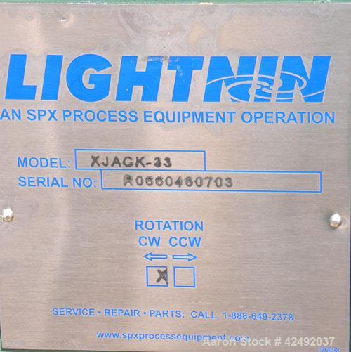 Used- Lightnin Fixed Mount, Open Tank Design Air Operated Agitator, Model XJACK-33. Clockwise rotation. Approximate 4'' diam...