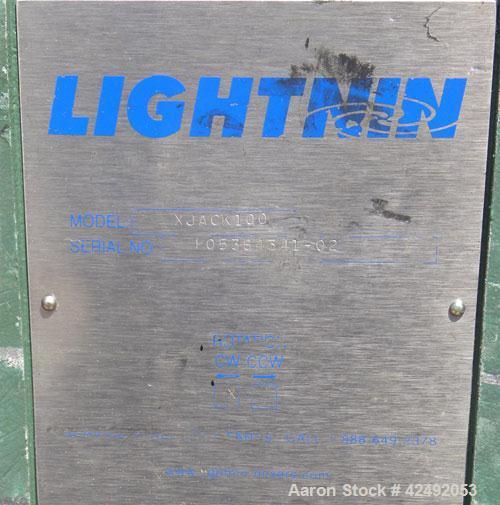 Used- Lightnin Fixed Mount, Open Tank Design, Air Operated Agitator, Model XJACK100. Clockwise rotation. Approximate 4'' dia...