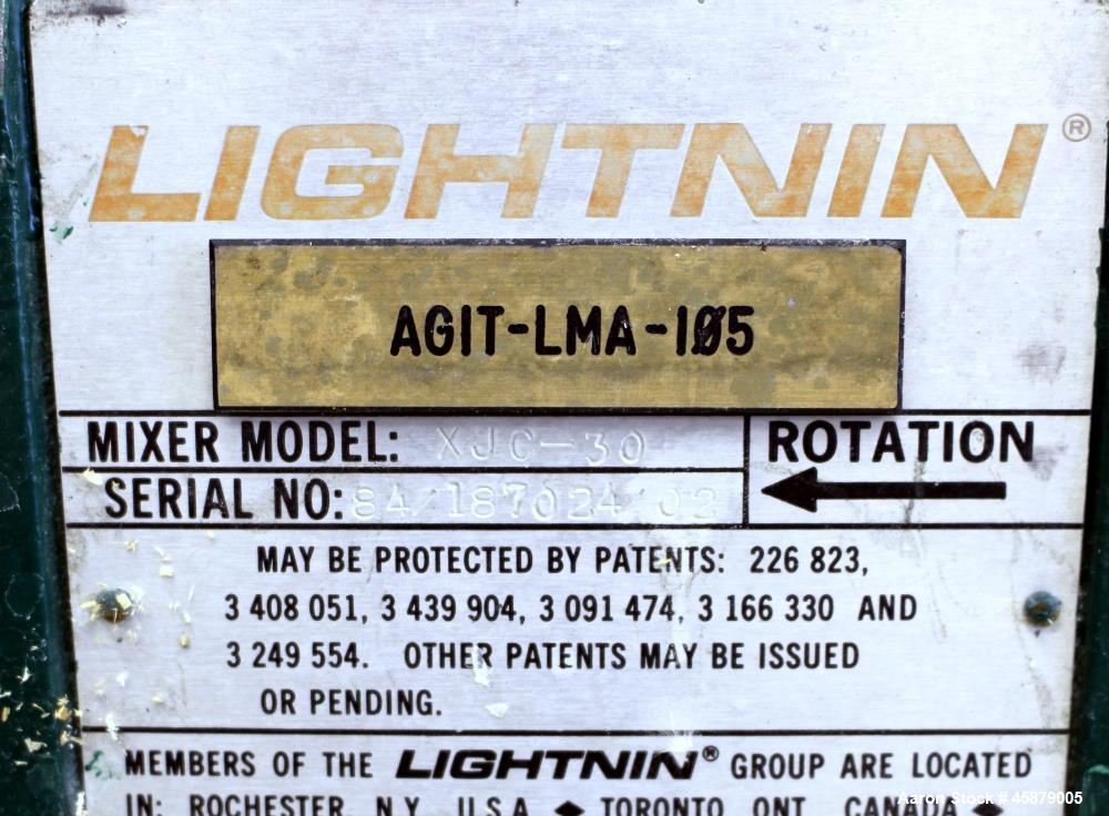 "Used- Lightnin Top Entering Agitator, Model XJC-30. Includes an approximate 4"" diameter stub shaft 4 hole shaft mounting fla..."