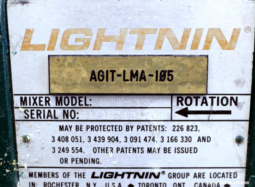 "Used- Lightnin Top Entering Agitator, Model XJC-30. Includes an approximate 4"" diameter stub shaft 4 hole shaft mounting fla..."
