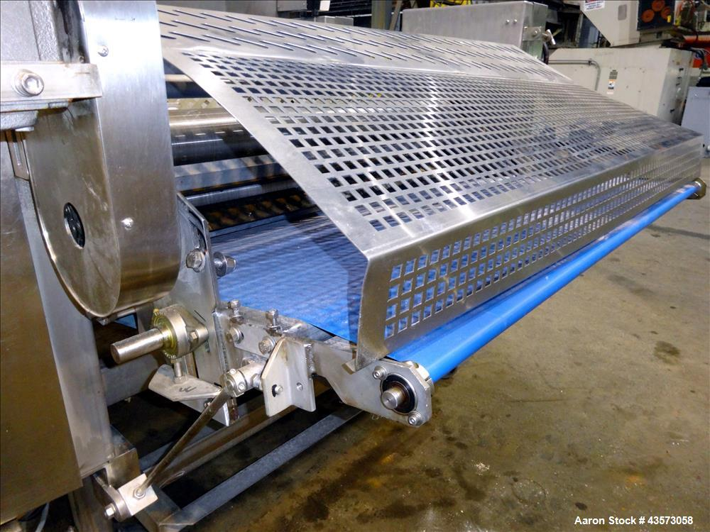 "Used- 48"" Wide Gauging Roller, Stainless Steel Construction. Infeed conveyor approximate 48"" wide x 30"" long, driven by 1.32..."