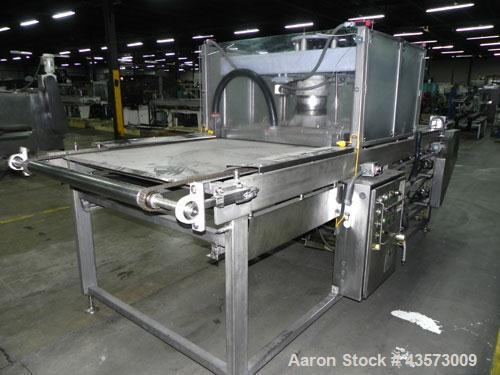 Used- AM Manufacturing Model Toro 2040 Dough Press. Rated at 400 dozen presses per hour. Fully adjustable heat, pressure, an...