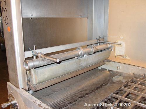 """USED: Baker Perkins chocolate enrober, stainless steel. 35"""" wide x 50"""" long stainless steel mesh conveyor belt. 23"""" wide x 6..."""