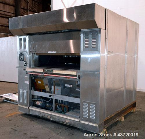 "Used- Baxter Revolving Tray Oven, Model OV850G-12A.  Natural gas fired, 150,000 BTU.  (4) Approximately 58"" wide x 26"" deep ..."