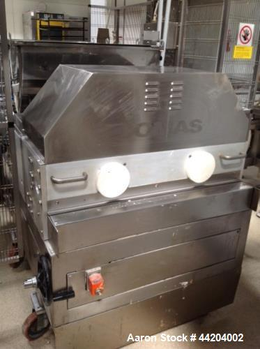 Used- Comas DI 800 Filler for Bakery Products, (e.g. donut , croissant, sweet cakes). Equipped with (2) heads, (10) rows, wi...