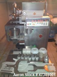 Used- Rheon KN400 Encrusting Machine. 3.2 Kw, 1455 mm high x 2059 mm wide x 966 mm deep. Product weight range: 10-300 grams,...