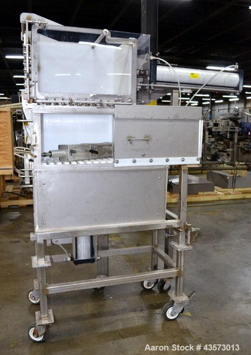 Used- Cheese Block Cutter/Portioner. Machine is of stainless steel construction. Designed to cut blocks approximately (lengt...
