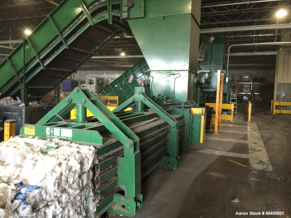 """Used- C & M Wide Mouth Auto Tie Baler, Model 6046-30-AT510. Feed opening: 60"""" long x 46"""" wide. Bale size: 46"""" wide x 30"""" hig..."""
