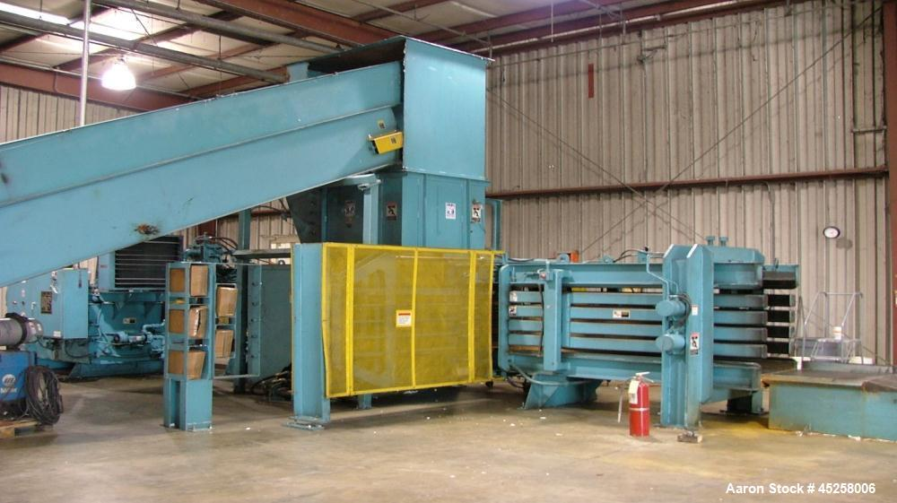 """Used- IPS Baler, Model AT-965.  Conquest single side hinge.  Dimensions:  34'10"""" long x 13'4"""" wide x 123"""" high.  Motor 100 h..."""