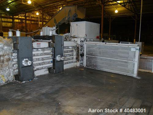 Used-Marathon auto tie baler, model AT-604242850A, driven by a 60 hp motor.