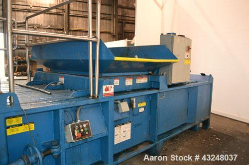 "Used- Excel Manufacturing Horizontal Baler, Model EX60II, Carbon Steel. Approximate bale size 30"" x 55"". Top feed with chute..."