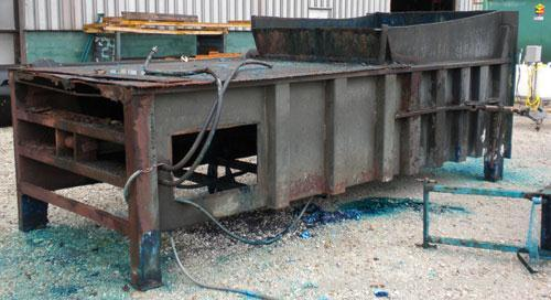 Used- Octagonal Dock Feed Trash Compactor, approximately 40 yard receiving container, carbon steel. Side swing closure door....
