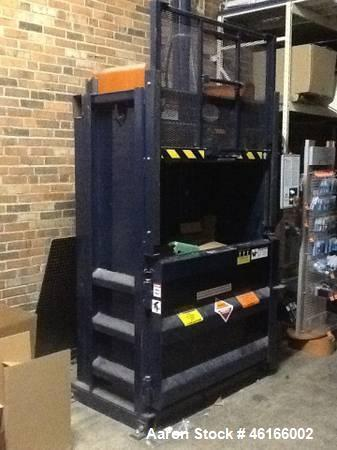Used- Cram-A-Lot Vertical Baler for recycle aluminum, plastic, cardboard and more. Hanges in baler technology in decades. Th...