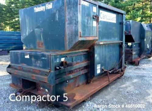 Used- Parker Trash Compactor. Capacity: 10 yards, measurements: 12 ft. x 7 ft. x 8 ft. Includes guide island, Model D3W8CNYC...
