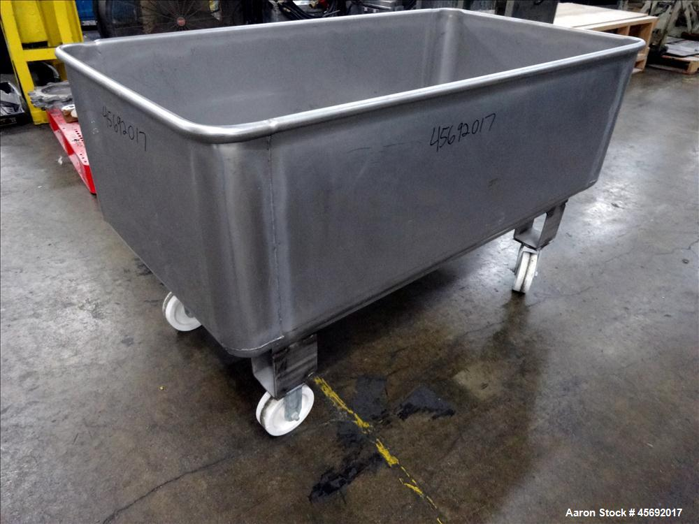 "Used- Stainless Steel Tub. Stainless steel tub 55-1/2"" long x 29-1/2"" wide x 19-1/2"" tall, 1-1/2"" diameter drain, mounted on..."