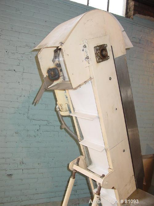 Used- Consolidated Packaging El Cap elevator. Stainless steel hopper 4' long x 2-1/2' wide with cleanout door. Incline belt:...
