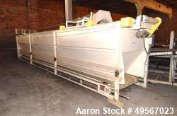"Used- Store-Veyor Belt Accumulator, Approximate 33' Long, Carbon Steel. Bottom belt approximate 84"" wide x 30' long. Top fee..."