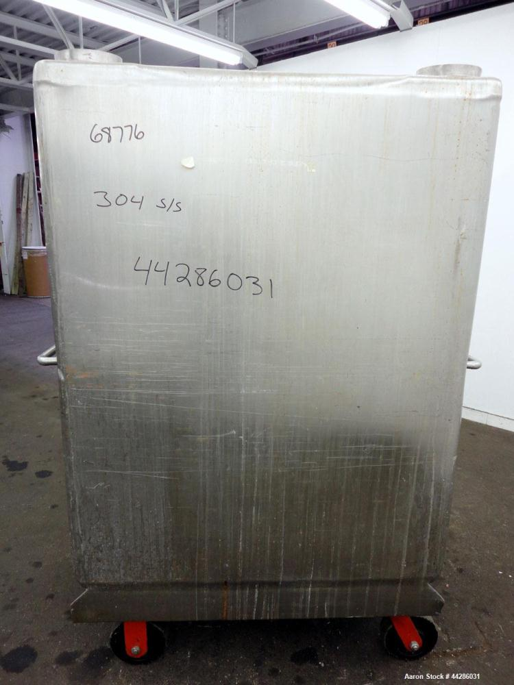 """Used- Portable Liquid Tote Bin, 66.8 Cubic Feet (500 Gallon), 304 Stainless Steel. Approximate 49"""" x 43"""" x 58"""" deep. Flat to..."""