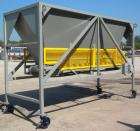 Used- Front End Loading Hopper/Feeder, approximate 10 ton storage capacity, approximate 150 cubic feet, carbon steel. Coned ...