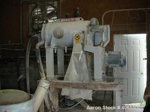 """Used-Pieralisi model Baby 1 solid bowl decanter centrifuge. Max bowl speed 5200 rpm, 35000 x """"G"""" force. Includes casing/stan..."""