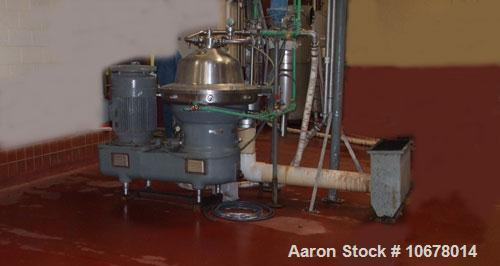Used-Westfalia Centrifuge, Disc Automatic, Model SB80-06-177. Allen Bradley control panel and CPU, base frame, tools, proces...