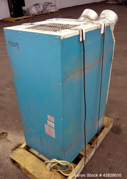 Used- Movincool Portable Air Cooled Air Conditioner, Model Classic Plus 26. Cooling capacity 2.2 tons, 24,000 btu/hr.