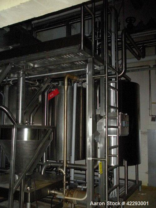 Used-4- Tank CIP System, Stainless steel construction System consists of three round single wall tanks, one large single wal...