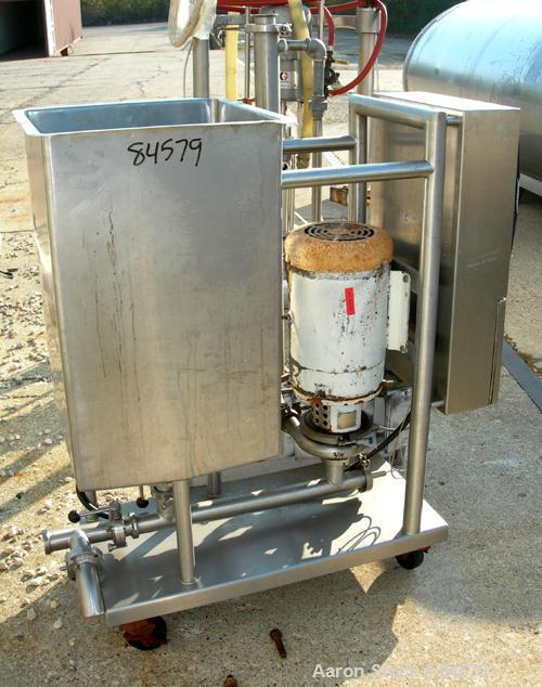 "USED: CIP system consisting of (1) 39 gallon 304 stainless steel tank, open top, no cover, flat bottom. 2"" center bottom out..."