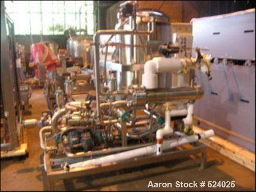 USED: Martin Peterson CIP skid with 200 gallon and 100 gallon stainless steel solution tanks, U-tube stainless steel heat ex...