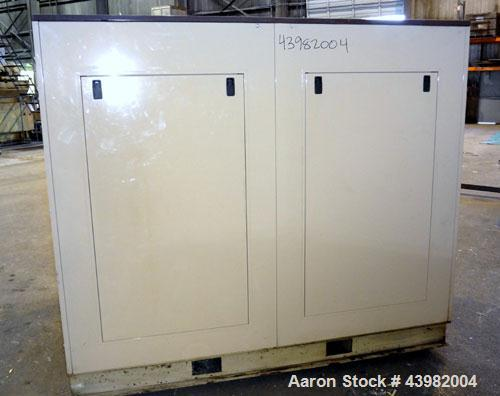 Used- Curtis RS Series Rotary Screw Compressor, Model R/S-150D-A/E-E75G. Air cooled, rated 706 cfm at 125 psi. Driven by a 1...