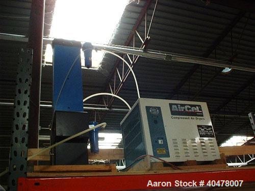 Used- Air drying system mounted above chiller.