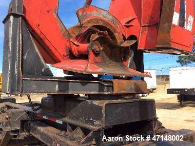 Used- Cat 559B Knuckleboom Loader. Grapple: 5055TW-R50.  Delimber: CTR426. Trailer: Evans D-48-HD. Hours 4255.