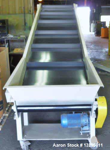 "Used- One 36"" wide x 13' long conveyor with bottom hopper. Painted with new cleated belt. On casters with adjustable legs."
