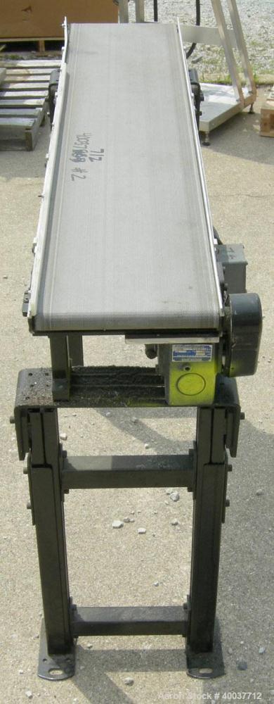 "Used- Dorner incline belt conveyor, series 2100. Model 2100-1004-05/04. 10"" wide x 48"" long cloth belt, driven by a 1/2hp, 3..."
