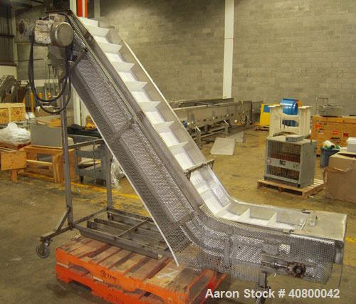 """Used-Inclined """"S""""ShapedConveyor, 304 stainless steel frame.14"""" wide x 3"""" tall cleated plastic belt,24"""" long bottom infee..."""