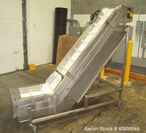 """Used-Trio-Pac Inclined """"S""""ShapedConveyor, 304 stainless steel frame.14"""" wide x 3"""" tall cleated plastic belt,24"""" long bot..."""