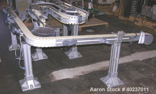 "Used- Autopack Belt Conveyor. 3 1/4"" wide x 84"" straight section x 1/4 circle left section x 64"" straight section. Driven by..."