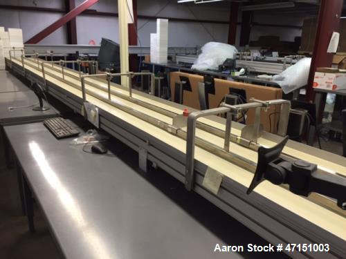 Used- Dorner Table-Top Belt Conveyor System;. 29 feet long x 20 inches wide. Constructed in three sections. Variable speed d...