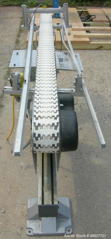 "Used- Flex-Link Belt Conveyor. 4"" wide x 70"" long plastic belt. Driven by a 1/2 HP, 3/60/208-230/460 Volt, 1725 RPM gearmoto..."