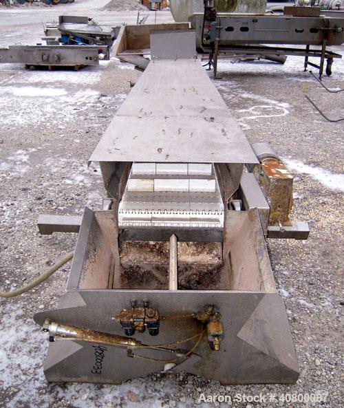 "Used- Heat and Control Inclined Belt Conveyor. 16"" wide x 192"" long plastic belt with 2"" high pleats. Bottom feed with hoppe..."