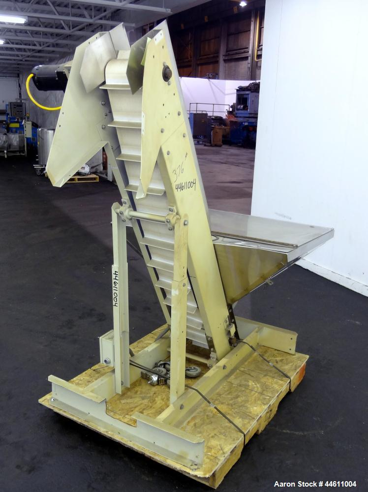 """Used- Hoppmann Elevating Prefeeder, Model EP, Series 8.  8"""" Wide rubber belt with 1-3/4"""" tall pleats placed approximately 6""""..."""