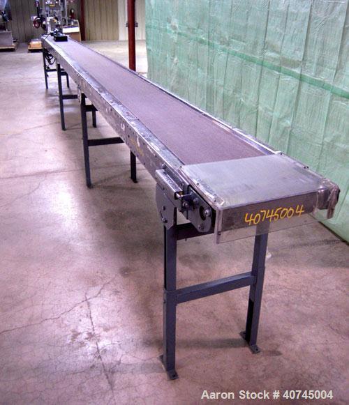 "Used- Hytrol Belt Conveyor. 13"" wide x 296"" long rubber belt, driven by a 1/2 hp, 90 volt, 1750 rpm DC gearmotor. Includes a..."