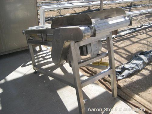 Used- Lyco incline conveyor 18 in wide x 5 ft long with 1 in H cleats.
